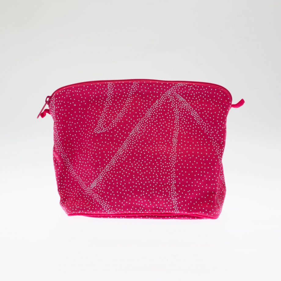 Large pink cotton lined wash bag with turquoise dot design.