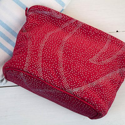 Large Pink silk screen washbag with pale blue swirl dot design