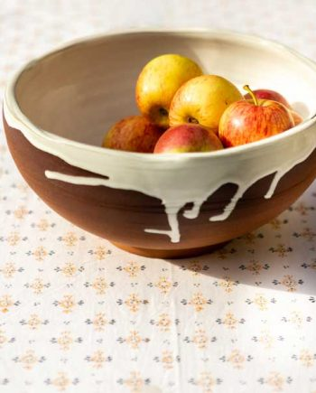 Block print tablecloth featuring orange flower with grey detail on white cotton